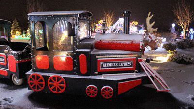 The Reindeer Express - a red and black train dusted in snow